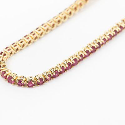 Bracciale tennis oro giallo 18kt con rubini