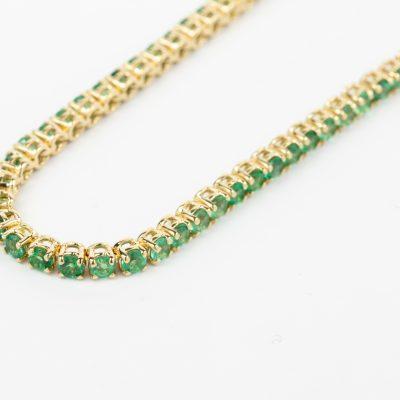 Bracciale tennis oro giallo 18kt con smeraldi
